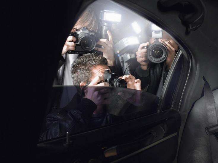 Paparazzi Shooting Through Car Window