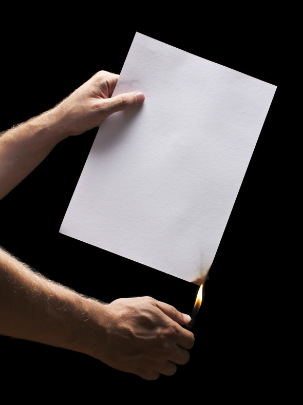 Man hand holding lighter and white burned paper - Shulman Law Firm